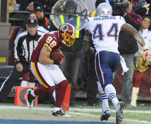 New England Patriots strong safety James Ihedigbo (44) watches Washington Redskins wide receiver David Anderson (88) catch a touchdown pass during the second half of an NFL football game on Sunday, Dec. 11, 2011, in Landover, Md.  (AP Photo/Rich Lipski)