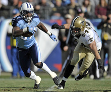 Tennessee Titans wide receiver Lavelle Hawkins, left, tries to evade New Orleans Saints linebacker Will Herring (54) in the second quarter of an NFL football game on Sunday, Dec. 11, 2011, in Nashville, Tenn. (AP Photo/Joe Howell)