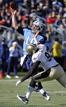 Tennessee Titans quarterback Jake Locker (10) passes as he is hit by New Orleans Saints defensive end Junior Galette (93) in the second quarter of an NFL football game on Sunday, Dec. 11, 2011, in Nashville, Tenn. (AP Photo/Frederick Breedon)
