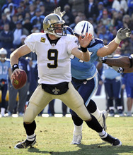 Tennessee Titans defensive tackle Karl Klug, rear, sacks New Orleans Saints quarterback Drew Brees (9) for a 7-yard loss during the second quarter of an NFL football game on Sunday, Dec. 11, 2011, in Nashville, Tenn. (AP Photo/Frederick Breedon)