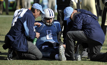 Tennessee Titans quarterback Matt Hasselbeck (8) is tended to on the field after injuring his left leg in the second quarter of an NFL football game against the New Orleans Saints, Sunday, Dec. 11, 2011, in Nashville, Tenn. (AP Photo/Joe Howell)