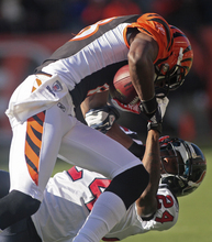 Houston Texans cornerback Johnathan Joseph (24) tackles Cincinnati Bengals wide receiver A.J. Green after a short reception in the first half of an NFL football game on Sunday, Dec. 11, 2011, in Cincinnati. (AP Photo/Tony Tribble)