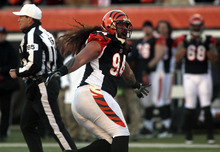 Cincinnati Bengals defensive tackle Domata Peko signals an incomplete pass in the first half of an NFL football game against the Houston Texans, Sunday, Dec. 11, 2011, in Cincinnati. (AP Photo/Tony Tribble)