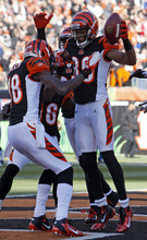 Cincinnati Bengals wide receiver Jerome Simpson (89) celebrates with Cincinnati Bengals wide receiver A.J. Green (18) after Simpson caught a touchdown pass against the Houston Texans in the first half of an NFL football game on Sunday, Dec. 11, 2011, in Cincinnati. (AP Photo/David Kohl)