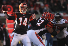 Cincinnati Bengals quarterback Andy Dalton (14) passes against the Houston Texans in the first half of an NFL football game on Sunday, Dec. 11, 2011, in Cincinnati. (AP Photo/Tony Tribble)
