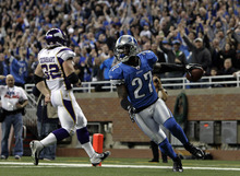 Detroit Lions defensive back Alphonso Smith (27) intercepts a pass from Minnesota Vikings quarterback Christian Ponder for a 30-yard touchdown in the second quarter of an NFL football game in Detroit, Sunday, Dec. 11, 2011. (AP Photo/Paul Sancya)