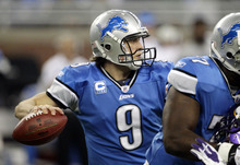 Detroit Lions quarterback Matthew Stafford (9) looks downfield during the first quarter of an NFL football game against the Minnesota Vikings in Detroit, Sunday, Dec. 11, 2011. (AP Photo/Paul Sancya)
