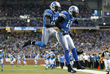 Detroit Lions wide receiver Titus Young, right, and wide receiver Nate Burleson, left, celebrate Young's touchdown in the first quarter of an NFL football game against the Minnesota Vikings in Detroit on Sunday , Dec. 11, 2011. (AP Photo/Rick Osentoski)