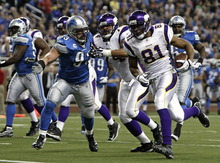 Minnesota Vikings tight end Visanthe Shiancoe (81) scores on a 7-yard touchdown reception against the Detroit Lions in the first quarter of an NFL football game in Detroit, Sunday, Dec. 11, 2011. (AP Photo/Paul Sancya)