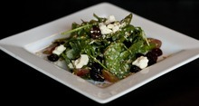 Chris Detrick     The Salt Lake Tribune The Market Salad with spinach, dried cherries, feta, toasted almonds, grapes, at Pago Tuesday December 6, 2011. Pago builds its menu around the products it can buy locally, like beef, lamb, pork, produce, even the tequila it uses is locally made. Inside, products are sustainable too: It is making drinking glasses out of the wine bottles it uses; tables are reclaimed wood; countertops are from recycled paper.