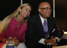 Leah Hogsten  |  Tribune file photo Dallin Larsen, right, with wife. Karree Larsen. is the founder, chairman and CEO of MonaVie, a nutritional drink company that says it has sold $2 billion worth of its products since its founding in 2005.