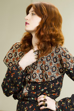 Florence Welch, lead singer of Florence and the Machine, poses for a portrait in New York, Monday, Nov. 21, 2011. (AP Photo/Charles Sykes)