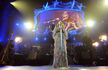 Florence Welch, of Florence and The Machine performs live at KROQ Almost Acoustic Christmas Night Two in The Gibson Ampitheater, Sunday, Dec. 11, 2011, in Los Angeles.  KROQ Almost Acoustic Christmas Night 2 proceeds benefit the Al Wooten Jr Heritage Center. (AP Photo/Katy Winn)
