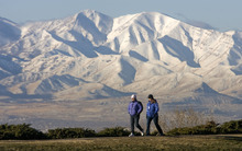 Al Hartmann  |  The Salt Lake Tribune Brigitte Klement, left, and Sarah Lehmann take their morning walk at 11th Avenue Park high in Salt Lake's Avenues with the snowy Oquirrh Mountains in the distance. Just because it's cold doesn't mean to cut back on hydration when excercising in the winter.
