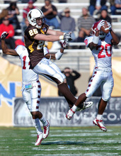 Temple defensive back Kee-ayre Griffin (20) intercepts a pass intended for Wyoming tight end Spencer Bruce (25) in the second quarter of the New Mexico Bowl NCAA college football game in Albuquerque, N.M., Saturday, Dec. 17, 2011. (AP Photo/Jake Schoellkopf)