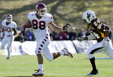 Temple tight end Evan Rodriguez (88) tries to evade Wyoming defensive back Kenny Browder (24) during the first quarter of the New Mexico Bowl NCAA college football game in Albuquerque, N.M., Saturday, Dec. 17, 2011. (AP Photo/Jake Schoellkopf)