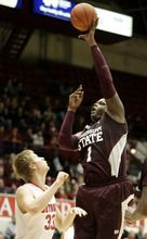 Mississippi State forward Renardo Sidney (1) shoots over Detroit's Evan Bruinsma (33) in the first half of an NCAA college basketball game on Saturday, Dec. 17, 2011, in Detroit. (AP Photo/Duane Burleson)