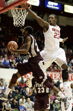 Detroit forward Doug Anderson (23) goes up high to defend against a shot by Mississippi State guard Brian Bryant (22)  in the first half of an NCAA college basketball game Saturday, Dec. 17, 2011, in Detroit. (AP Photo/Duane Burleson)