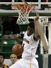 Baylor's Perry Jones III (1) dunks against Prairie View A&M in the first half of an NCAA college basketball game, Tuesday, Nov. 29, 2011, in Waco, Texas. (AP Photo/Tony Gutierrez)