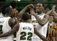 Baylor forward Perry Jones III, top right, reacts with teammates after dunkng against Prairie View A&M in the first half of an NCAA college basketball game, Tuesday, Nov. 29, 2011, in Waco, Texas. (AP Photo/Tony Gutierrez)
