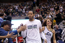 Jeremy Harmon  |  The Salt Lake Tribune  Utah's Devin Harris is escorted onto the court by one of the Jazz dancers prior to a scrimmage at EnergySolutions Arena in Salt Lake City, Saturday, Dec. 17, 2011.