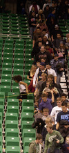 Jeremy Harmon  |  The Salt Lake Tribune  Fans pile into an empty section of seating at a Utah Jazz scrimmage at EnergySolutions Arena in Salt Lake City, Saturday, Dec. 17, 2011.