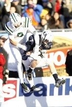 Chris Detrick  |  The Salt Lake Tribune Utah State Aggies wide receiver Travis Van Leeuwen (7) makes a catch past Ohio Bobcats safety Josh Kristoff (9) during the first half of the Famous Idaho Potato Bowl at Bronco Stadium Saturday December 17, 2011.