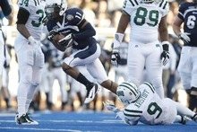 Chris Detrick  |  The Salt Lake Tribune Utah State Aggies wide receiver Stanley Morrison (11) runs past Ohio Bobcats safety Josh Kristoff (9) during the first half of the Famous Idaho Potato Bowl at Bronco Stadium Saturday December 17, 2011.