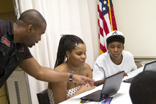Michael Thomas, left, local advocate in Tampa, Fla., works with students in the American Academy's No Dropouts program. Courtesy photo