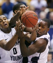 Steve Griffin  |  The Salt Lake Tribune  BYU's Brandon Davies and Charles Abouo battle Baylor's Quincy Miller for a rebound during frist half action of the BYU Baylor basketball game  in Provo, Utah Saturday, December 17, 2011.