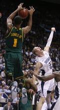 Steve Griffin  |  The Salt Lake Tribune  BYU's MAte Austin can't stop a lob pass as Byalor's Perry Jones III leaps towards the basket during frist half action of the BYU Baylor basketball game  in Provo, Utah Saturday, December 17, 2011.