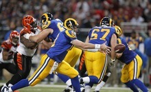 St. Louis Rams quarterback Kellen Clemens (10) pitches the ball during the first quarter of an NFL football game against the Cincinnati Bengals Sunday, Dec. 18, 2011, in St. Louis. (AP Photo/Jeff Roberson)