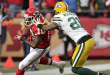 Kansas City Chiefs wide receiver Terrance Copper (10) is pushed out of bounds by Green Bay Packers cornerback Charles Woodson (21) during the first half of an NFL football game at Arrowhead Stadium in Kansas City, Mo., Sunday, Dec. 18, 2011. (AP Photo/Charlie Riedel)