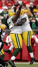 Green Bay Packers defensive end Howard Green, left, and tackle B.J. Raji (90) celebrate after stopping a Kansas City Chiefs drive on the fourth down for a turnover during the first half of an NFL football game Sunday, Dec. 18, 2011, in Kansas City, Mo. (AP Photo/Charlie Riedel)