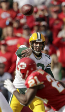 Green Bay Packers quarterback Aaron Rodgers (12) passes during the first half of an NFL football game against the Kansas City Chiefs on Sunday, Dec. 18, 2011, in Kansas City, Mo. (AP Photo/Charlie Riedel)