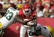 Kansas City Chiefs running back Dexter McCluster (22) is tackled by Green Bay Packers outside linebacker Erik Walden (93) and strong safety Charlie Peprah (26) during the first half of an NFL football game at Arrowhead Stadium in Kansas City, Mo., Sunday, Dec. 18, 2011. (AP Photo/Charlie Riedel)