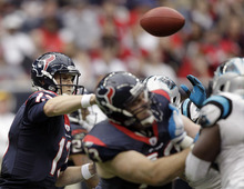 Houston Texans quarterback T.J. Yates (13) throws a pass against the Carolina Panthers in the second quarter of an NFL football game on Sunday, Dec. 18, 2011, in Houston. (AP Photo/David J. Phillip)