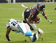 Houston Texans running back Arian Foster (23) is upended by Carolina Panthers strong safety Jordan Pugh (29) during the third quarter of an NFL football game on Sunday, Dec. 18, 2011, in Houston. (AP Photo/Dave Einsel)