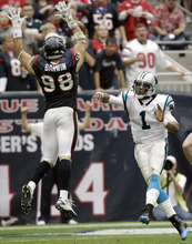 Carolina Panthers quarterback Cam Newton (1) throws a pass as Houston Texans outside linebacker Connor Barwin (98) tries to deflect it during the third quarter of an NFL football game on Sunday, Dec. 18, 2011, in Houston. The pass was incomplete. (AP Photo/David J. Phillip)