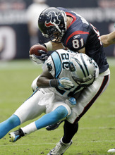 Houston Texans tight end Owen Daniels (81) is hit by Carolina Panthers cornerback Chris Gamble (20), leading to a turnover, in the second quarter of an NFL football game on Sunday, Dec. 18, 2011, in Houston. (AP Photo/David J. Phillip)