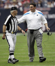 Carolina Panthers coach Ron Rivera, right, talks with an official in the second quarter of an NFL football game against the Houston Texans, Sunday, Dec. 18, 2011, in Houston. (AP Photo/David J. Phillip)
