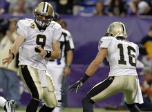 New Orleans Saints' Lance Moore (16) celebrates his touchdown catch with quarterback Drew Brees (9) during the first half of an NFL football game against the Minnesota Vikings Sunday, Dec. 18, 2011, in Minneapolis. (AP Photo/Genevieve Ross)
