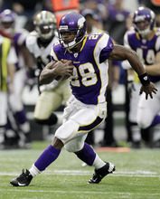 Minnesota Vikings' Adrian Peterson (28) breaks away for a 39-yard run during the first half of an NFL football game against the New Orleans Saints Sunday, Dec. 18, 2011, in Minneapolis. (AP Photo/Charlie Neibergall)