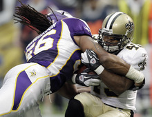 New Orleans Saints' Darren Sproles (43) catches a 13-yard touchdown pass in front of Minnesota Vikings' E.J. Henderson (56) during the first half of an NFL football game Sunday, Dec. 18, 2011, in Minneapolis. (AP Photo/Charlie Neibergall)
