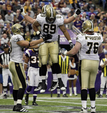 New Orleans Saints' John Gilmore (89) celebrates his touchdown reception with teammates during the second half of an NFL football game against the Minnesota Vikings Sunday, Dec. 18, 2011, in Minneapolis. (AP Photo/Genevieve Ross)