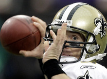 New Orleans Saints quarterback Drew Brees throws during the first half of an NFL football game against the Minnesota Vikings Sunday, Dec. 18, 2011, in Minneapolis. (AP Photo/Charlie Neibergall)
