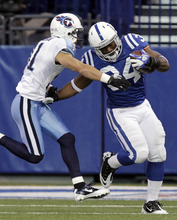 Indianapolis Colts running back Delone Carter is tackled by Tennessee Titans cornerback Cortland Finnegan during the second quarter of an NFL football game in Indianapolis, Sunday, Dec. 18, 2011. (AP Photo/AJ Mast)