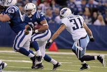 Indianapolis Colts running back Donald Brown, left, gets past Tennessee Titans cornerback Cortland Finnegan during the first quarter of an NFL football game in Indianapolis, Sunday, Dec. 18, 2011. (AP Photo/Darron Cummings)