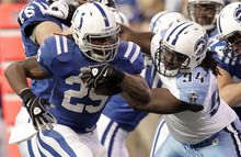 Indianapolis Colts running back Joseph Addai, left, gets past Tennessee Titans defensive tackle Sen'Derrick Marks during the first quarter of an NFL football game in Indianapolis, Sunday, Dec. 18, 2011. (AP Photo/AJ Mast)