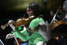 Kim Raff | The Salt Lake Tribune Freelance violinst Meredith Campbell rehearses for Kurt Bestor's Christmas concert at Abravanel Hall in Salt Lake City on Thursday, Dec. 8, 2011.